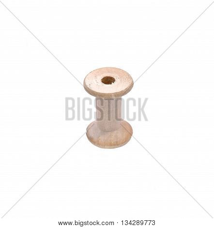 Empty wooden reel of thread isolated on white background