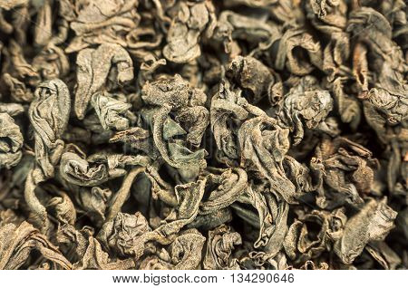 Pile Of Aromatic Green Tea As Background Closeup