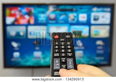 Smart tv and hand hold the remote control