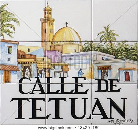 MADRID. SPAIN - MARCH 13. 2016 : Closeup of the street sign. Street signs in Madrid are hand-painted ceramic tiles typically composed within 9 or 12 tiles. They depict the name of the alley or street.