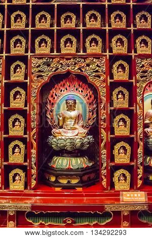 SINGAPORE - AUGUST 6. 2014: Detail from the Buddha Tooth Relic Temple in Singapore. The temple was opened at 2007 and become a popular attraction within Singapore Chinatown.