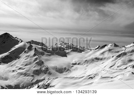 Black and white snowy mountains in evening. Caucasus Mountains. View from mt. Elbrus.