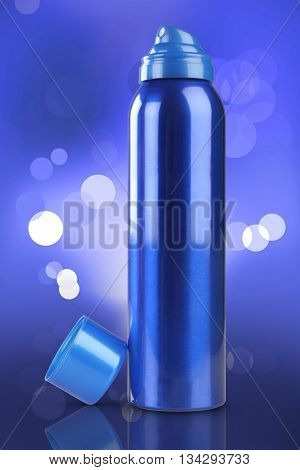 Blue Deodorant Perfume Can or Bottle with reflection