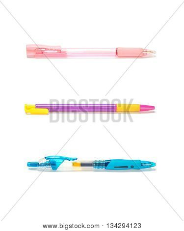 Closeup colorful pens pink pen purple pen blue pen isolated on white background