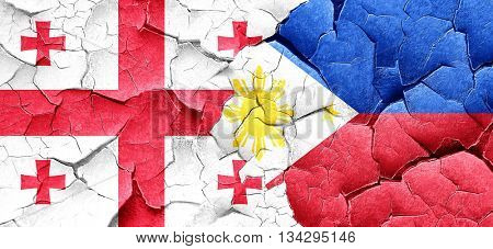 Georgia flag with Philippines flag on a grunge cracked wall