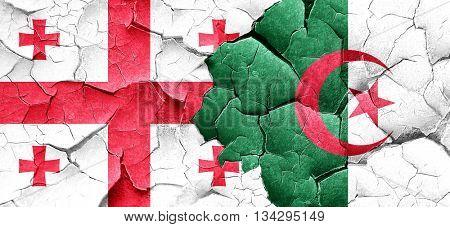 Georgia flag with Algeria flag on a grunge cracked wall