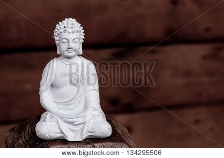 White Buddha - peaceful mind on dark background.