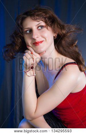 beautiful young brunette portrait shot in studio on dark background