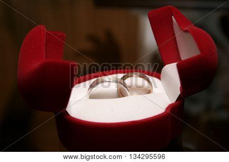 gold wedding rings on the pincushion gold wedding ring