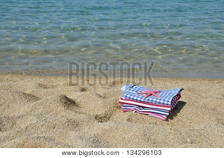 Navy look summer clothes with sea star on it and with sea in background