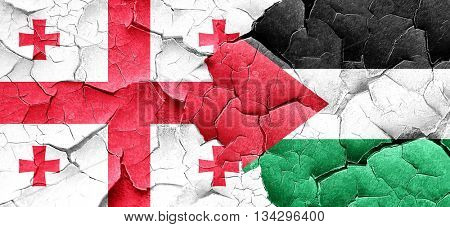 Georgia flag with Palestine flag on a grunge cracked wall