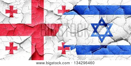 Georgia flag with Israel flag on a grunge cracked wall