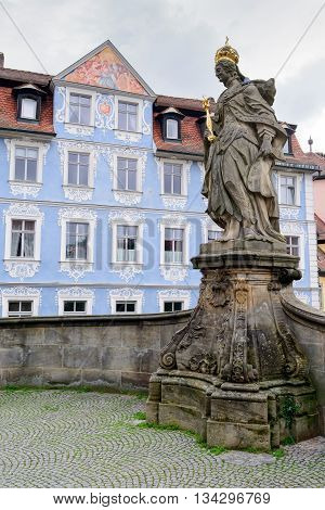 The statue is situated on the bridge near the Old town hall Bamberg
