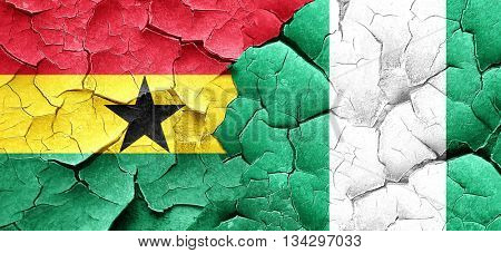 Ghana flag with Nigeria flag on a grunge cracked wall