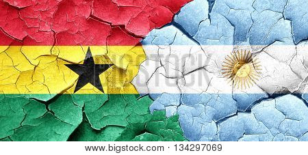 Ghana flag with Argentine flag on a grunge cracked wall