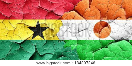 Ghana flag with Niger flag on a grunge cracked wall