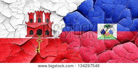 gibraltar flag with Haiti flag on a grunge cracked wall