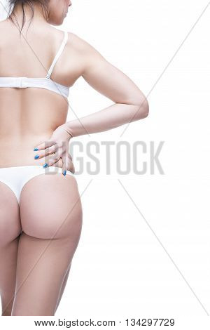 Back and buttocks. Beautiful female body with copy space. Isolated on white background