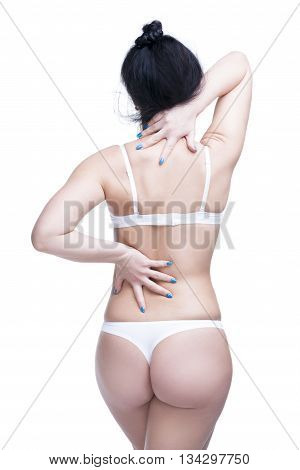 Back and buttocks. Beautiful female body. Isolated on white background
