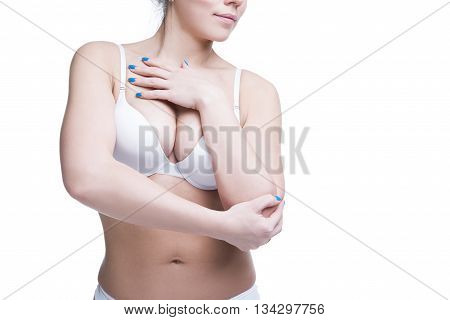 Young beautiful caucasian woman with large natural breasts. Copy space. Isolated on white background