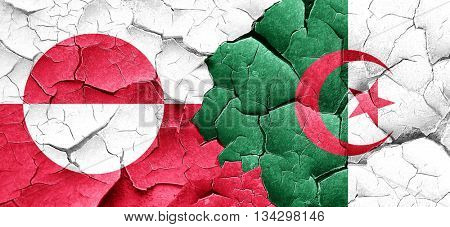 greenland flag with Algeria flag on a grunge cracked wall