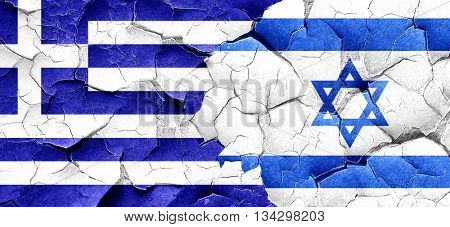 Greece flag with Israel flag on a grunge cracked wall