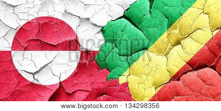 greenland flag with congo flag on a grunge cracked wall