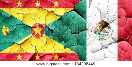 Grenada flag with Mexico flag on a grunge cracked wall