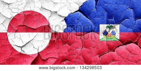 greenland flag with Haiti flag on a grunge cracked wall