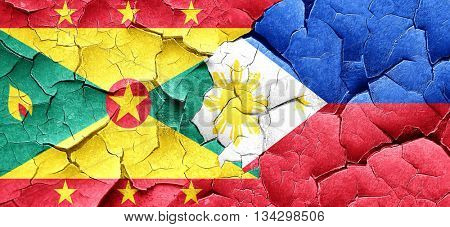 Grenada flag with Philippines flag on a grunge cracked wall