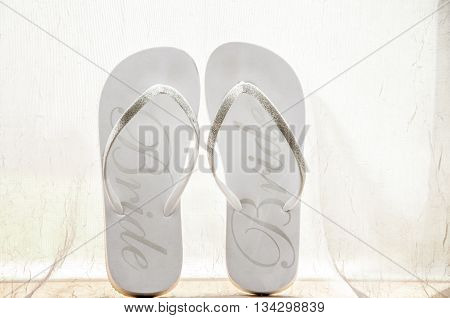 Picture of a bride's flip flops before she puts them on for the day.