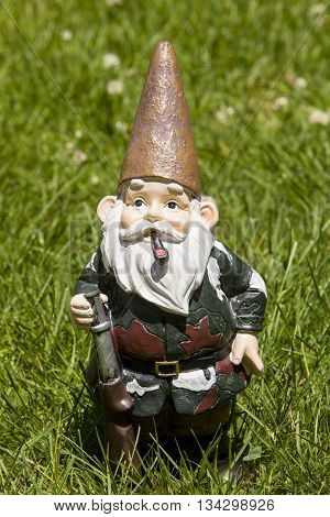 A hunter gnome stands in the grass