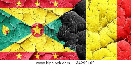 Grenada flag with Belgium flag on a grunge cracked wall