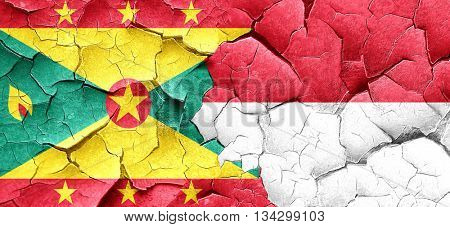 Grenada flag with Indonesia flag on a grunge cracked wall