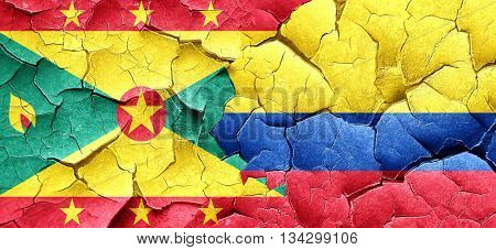 Grenada flag with Colombia flag on a grunge cracked wall