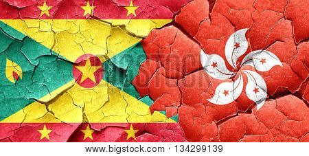 Grenada flag with Hong Kong flag on a grunge cracked wall
