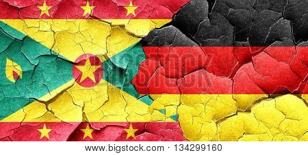 Grenada flag with Germany flag on a grunge cracked wall