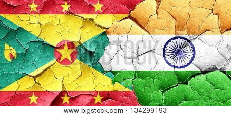 Grenada flag with India flag on a grunge cracked wall