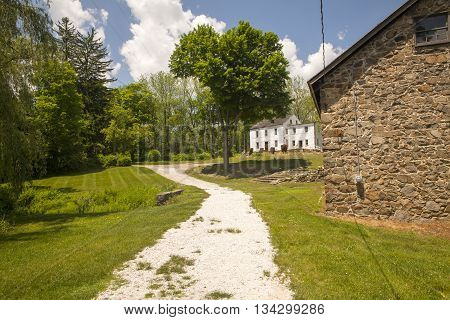 A gravel path leads to the old house in Waterloo Village