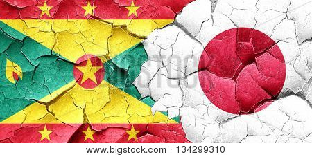 Grenada flag with Japan flag on a grunge cracked wall