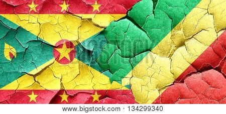 Grenada flag with congo flag on a grunge cracked wall