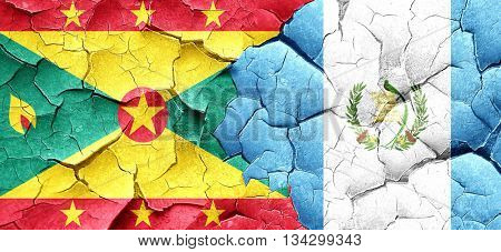 Grenada flag with Guatemala flag on a grunge cracked wall