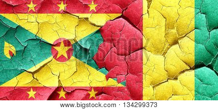 Grenada flag with Guinea flag on a grunge cracked wall