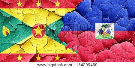 Grenada flag with Haiti flag on a grunge cracked wall