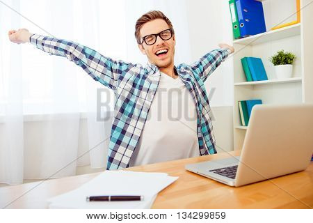 Handsome Man In Glasses Stretching And Yawning After Long Workin