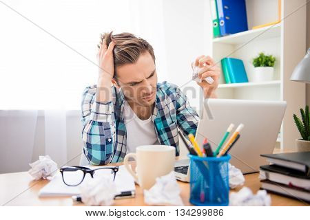Portrait Of Depressed Young Man In Bad Mood Failing Task