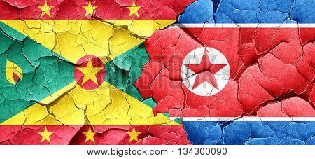 Grenada flag with North Korea flag on a grunge cracked wall