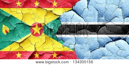 Grenada flag with Botswana flag on a grunge cracked wall