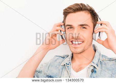 Portrait Of Happy Smiling Guy Listening Music In Headphones