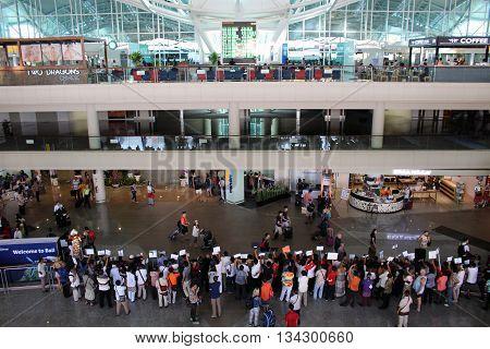 Denpasar, Indonesia - November 19, 2015: People waiting at the arrivals hall of Ngurah Rai International Airport (Denpasar) in Bali